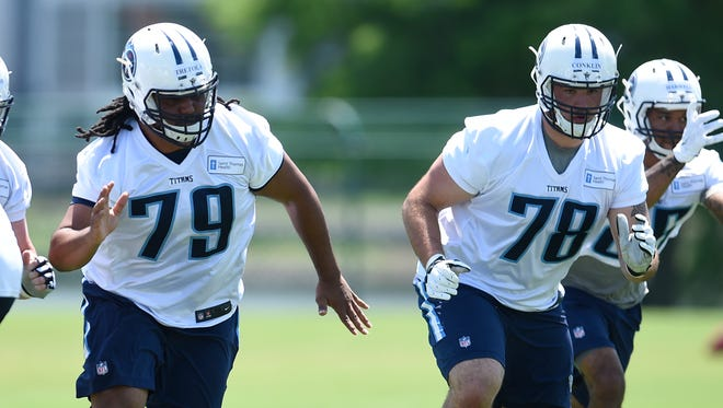 Titans offensive linemen Sebastian Tretola (79) and Jack Conklin (78) race up the field during rookie practice May 13, 2016.