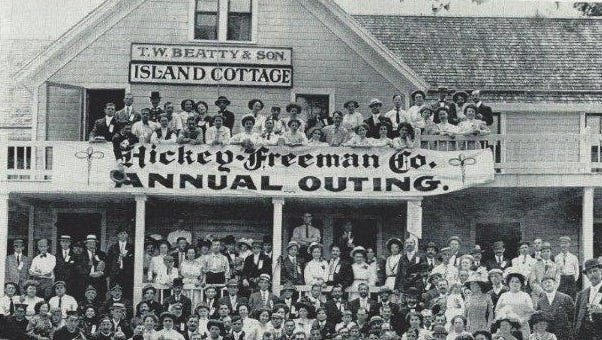 Hickey-Freeman workers pose with the 54th Regiment Band during the company picnic at Island Cottage in 1909.