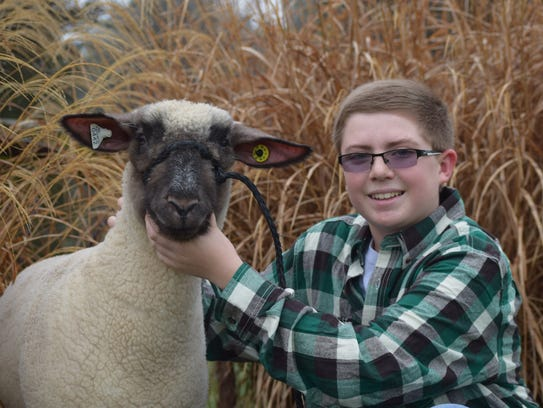 Clay Myers, 12, of Washington Township, poses with