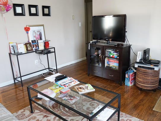 Glass tables, a television stand and makeshift table