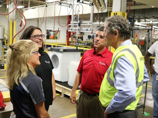 Sen. Sherrod Brown, right, speaks with two master trainers at Whirlpool, Laura Bannister and Lacy Newsom, during the senator's tour of the company's plant in Clyde in August 2017.