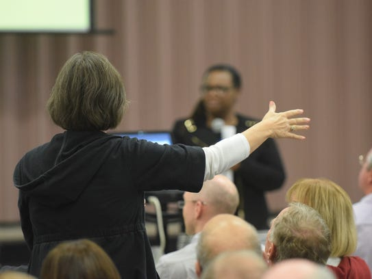 A woman asks a question of superintendent Traci Davis
