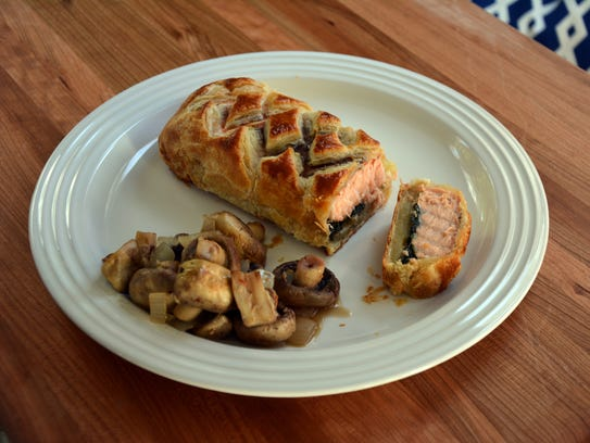 Salmon replaces beef in this puff pastry-encased Wellington,