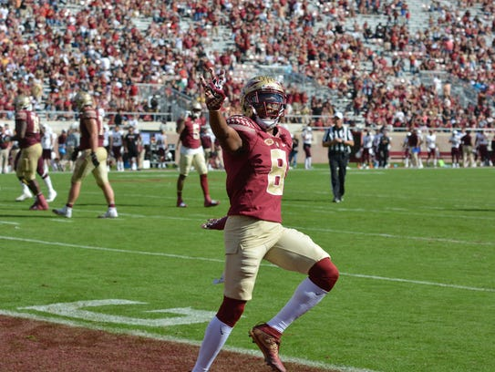 FSU junior wide receiver Nyqwan Murray celebrates a
