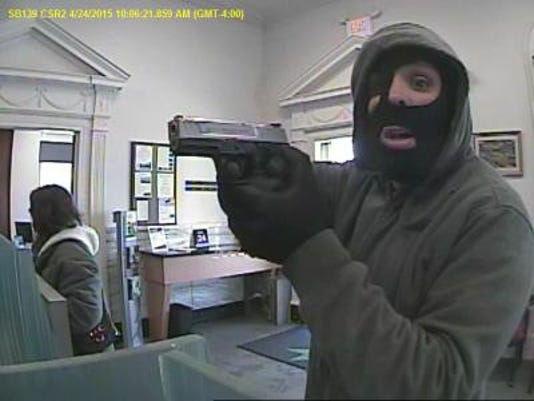 Do you recognize this gun-wielding bank robber? If so, call police right away.