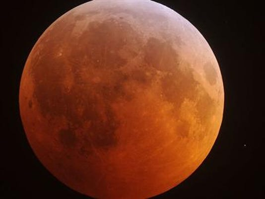 The eclipsed moon glows in the predawn sky Dec. 21, 2010, in a view from North Carolina.