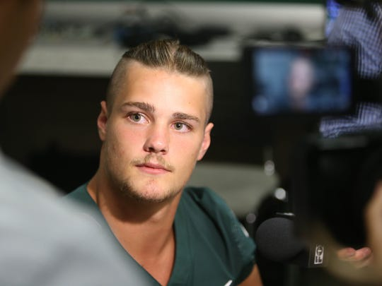 Michigan State defensive end Kenny Willekes talks with