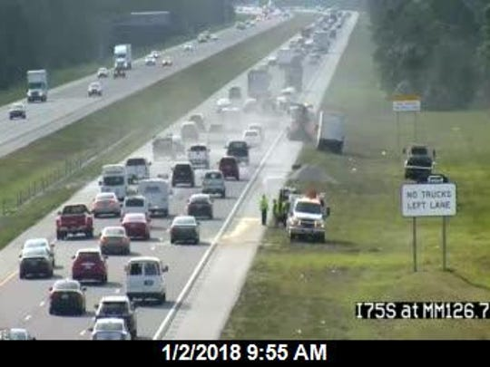 Southbound lanes on I-75 were reopened by 10 a.m. after a gravel truck spilled its load earlier.
