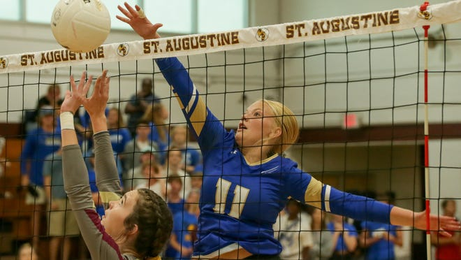Menendez's Ashlyn Banton (11) tries to deflect Annie Messler's set during a Sept. 24, 2019 volleyball match at St. Augustine High School.