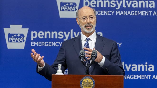 FILE - In this May 29, 2020 file photo, Pennsylvania Gov. Tom Wolf meets with the media at The Pennsylvania Emergency Management Agency (PEMA) headquarters in Harrisburg, Pa.  On Tuesday, Wolf urged state legislators to take action to prevent people who may be still struggling financially because of COVID-19 from losing their homes.
