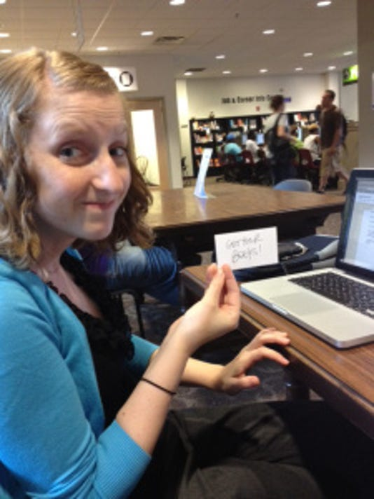 This is how excited I was last time I did some mobile journalism, then at Martin Library. (I'm holding a reminder to pick up my books!)