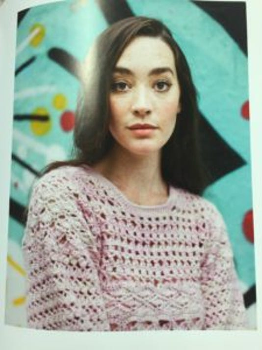 I think this crochet sweater is beautiful. Of course, knowing me, I'd probably figure out how to knit a similar sweater, rather than crochet it.