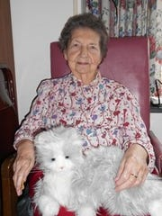Resident Betty Seilhamer sits with her cat at Quincy Village in Waynesboro. Seilhamer was recently widowed and has found comfort in the electronic cat during the grieving process.