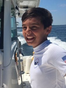 Ten-year-old Nico Mallozzi died of complications from flu during trip to a hockey tournament.