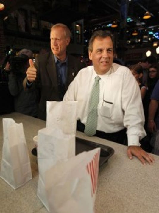 Gov. Chris Christie and gubernatorial candidate Bruce Rauner in Illinois recently. (AP Photo/Stacy Thacker)