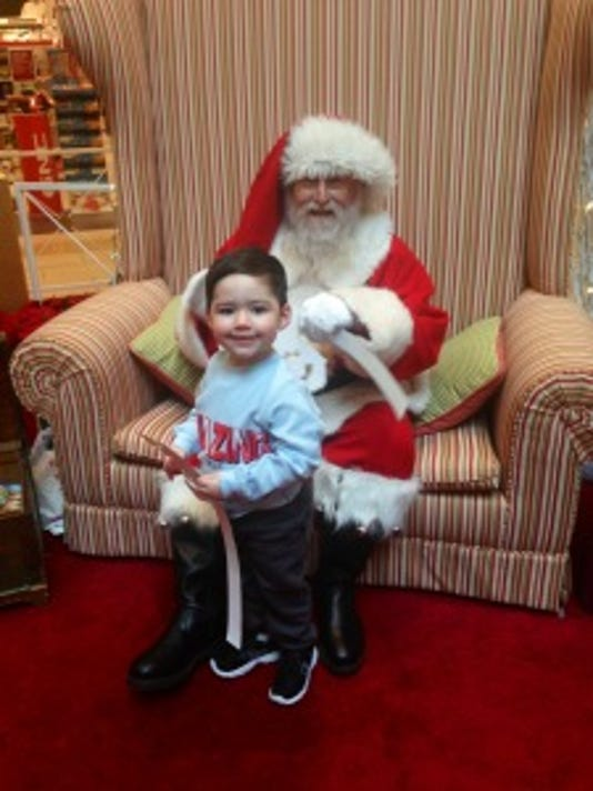 My son Dylan stands proudly with Santa at the Monmouth Mall in Eatontown. Thankfully, he's still young enough to believe in the magic of this world.