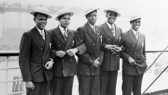 Olympic athletes Jimmy LuValle (from left), Archie Williams, John Woodruff, Benjamin Johnson and Matthew Robinson are pictured aboard the S.S. Manhattan upon arrival in Hamburg. Their story is detailed in  Deborah Riley Draper's documentary 'Olympic Pride, American Prejudice.'