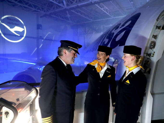 Flight attendants and a pilot of German carrier Lufthansa