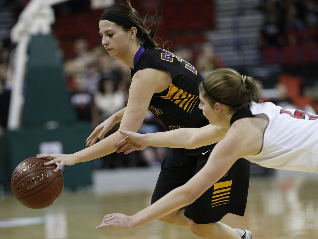 Barneveld's Mattie Schave, left, and South Shore's Morgan Sorenson battle for a loose ball during the first half of their Division 5 semifinals in the WIAA girls' state basketball championships Thursday, March 12, 2015 in Ashwaubenon.