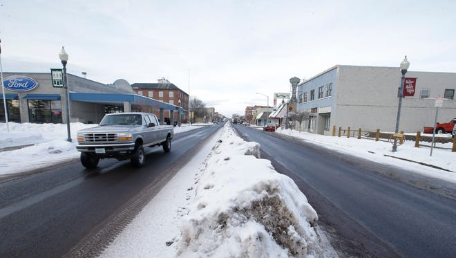 A truck travels down a street Monday, Jan. 4, 2016, in Burns, Ore. A group took over a remote national wildlife refuge near Burns as part of a decades-long fight over public lands in the West, while federal authorities are keeping watch but keeping their distance. The group came to the frozen high desert of eastern Oregon to contest the prison sentences of two ranchers who set fire to federal land, but their ultimate goal is to turn over the property to local authorities so people can use it free of U.S. oversight. (AP Photo/Rick Bowmer)
