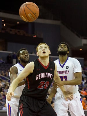 Southeast Missouri's Justin Carpenter (20) and University of Evansville's K.J. Riley (33) keep their eyes on the ball as the University of Evansville Purple Aces take on the Southeast Missouri Redhawks at the Ford Center in Evansville, Ind., on Thursday, Nov. 16, 2017. The Purple Aces won 66-50.