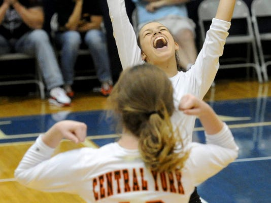 Julia Terpak, background, and Laura Fahs (No. 12) celebrate the Central York volleyball team's championship victory earlier in September at Dallastown High School against West York. (DAILY RECORD/SUNDAY NEWS -- JASON PLOTKIN)