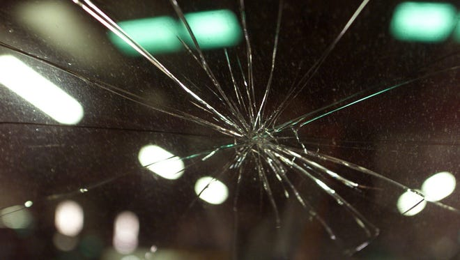 A cracked windshield is shown in this photo illustration.