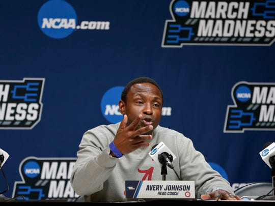 Alabama coach Avery Johnson takes questions during an NCAA men's college basketball tournament news conference, Friday, March 16, 2018, in Pittsburgh. Alabama faces Villanova in a second-round game on Saturday. (AP Photo/Keith Srakocic)