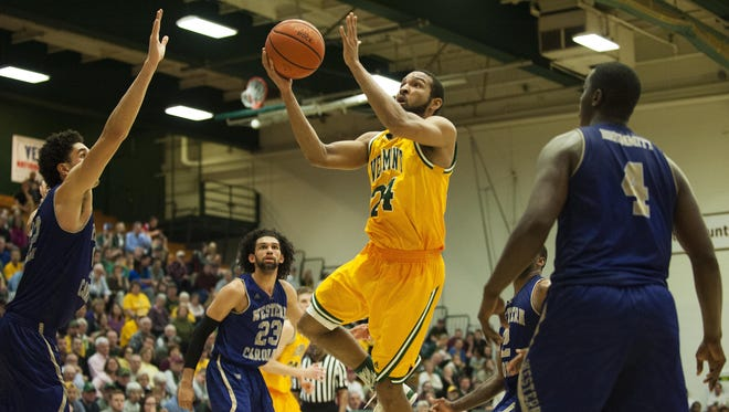 Catamounts guard Dre Wills (24) leaps to take a shot during the men's basketball game between the Western Carolina Catamounts and the Vermont Catamounts in the opening round of the College Basketball Invitational at Patrick Gym last week.