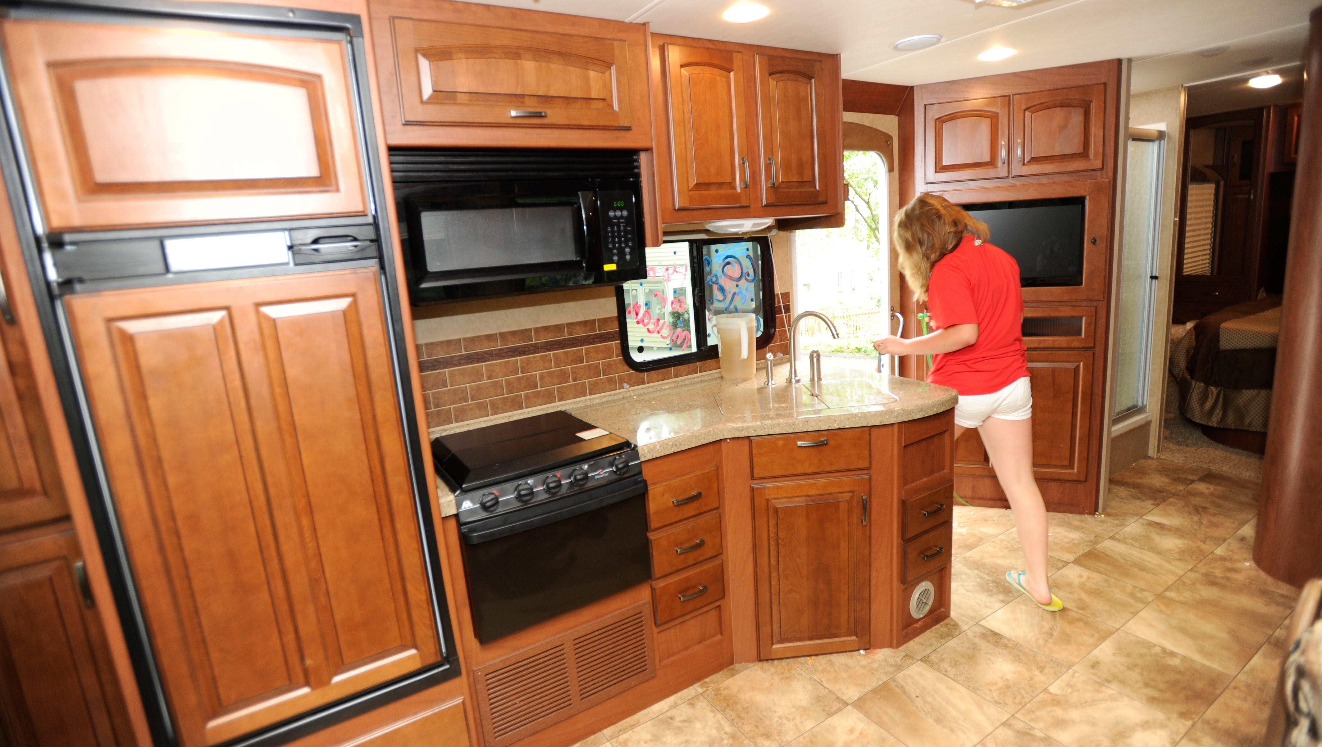 The RV has many of the kitchen amenities of home, including refrigerator, stove, cooktop, microwave and sink that can be covered to provide more counter space.