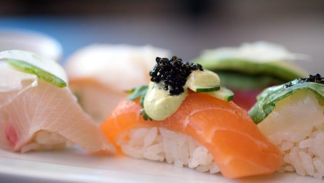 Save half off dinner menu items this week at Sushi Roku.