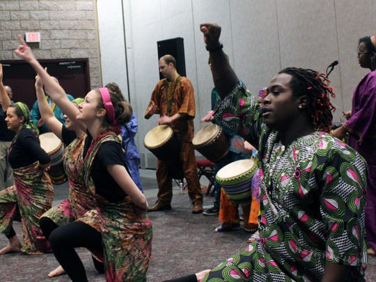 The Anderson University West African Drum Ensemble performs during the race relations conference Saturday at the Civic Center of Anderson.