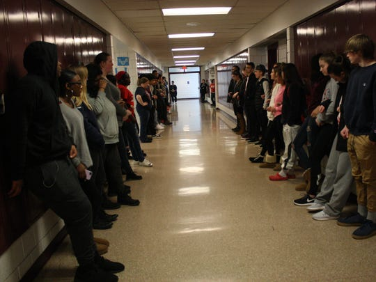 Binghamton High School students gather in the third-floor hallway during the nationwide walkout.