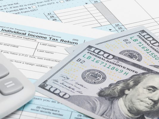 Tax Form, calculator and dollars - 1 to 1 ratio
