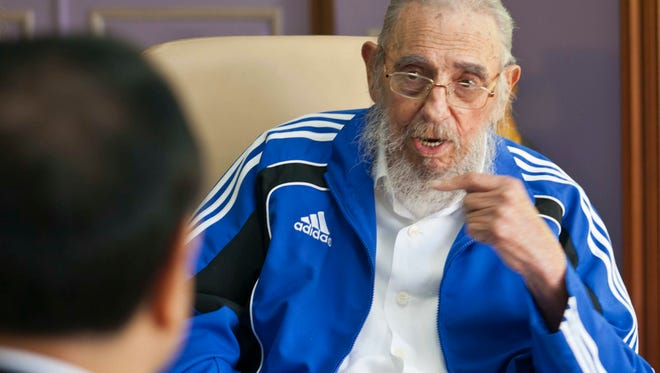 This Sept. 25, 2016, file photo shows Cuba's former leader Fidel Castro talking with China's Premier Li Keqiang, in one of the last pictures taken of Castro before he died.