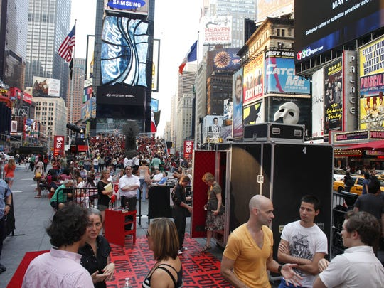"An audience member steps out of the ""Theatre for One"" performance space in New York's Times Square."