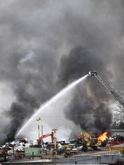 Parker District Fire Department firefighters work a