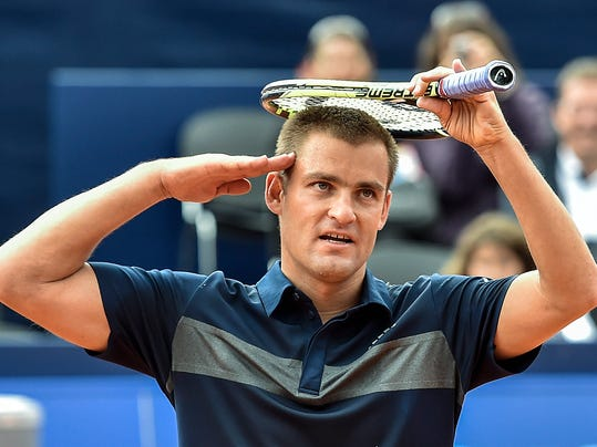 Mikhail Youzhny of Russia celebrates his victory against to Kenny De Schepper of France during the second round match at the Suisse Open tennis tournament in Gstaad, Switzerland, Thursday, July 24, 2014. (AP Photo/Keystone,Peter Schneider)