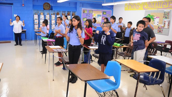 "In this file photo, Chamorro language teacher Delia Castro leads her sixth-grade class in the singing ""The Guam Hymn"" at V.S.A. Benavente Middle School in Dededo."