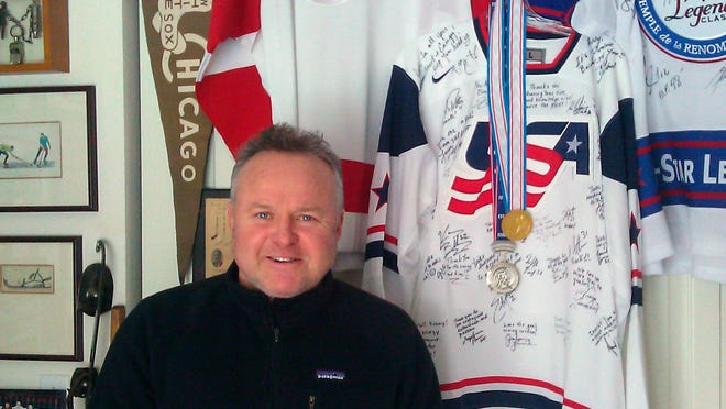 Kenny McCudden, of Crystal Lake, Ill, the skating and skills coach for the Chicago Wolves, poses for a photo in Crystal Lake. Ill. The longtime suburban Chicago hockey coach is headed to Russia to be skating and skills coach for the U.S. women's Olympic hockey team.