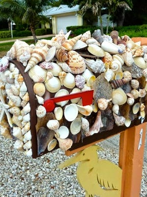 Update that old mail box with a coat of fresh paint... or seashells, whatever floats your boat.