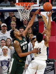 Lamar Stevens shoots over Michigan State's Nick Ward at The Palestra in Philadelphia on Jan. 7, 2017.