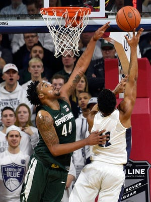 Jan 7, 2017; University Park, PA, USA; Penn State Nittany Lions forward Lamar Stevens shoots the ball past Michigan State Spartans forward Nick Ward during the first half at The Palestra.