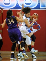 CooperÕs Cheyenne Sherwood (10) pulls down a rebound
