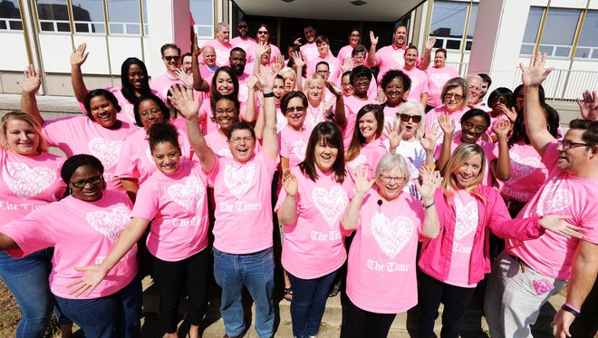 The Times staff show their support for Breast Cancer Awareness Month.