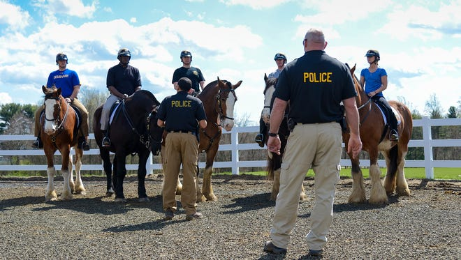 Police officers considering joining the mounted unit get a chance to ride horses at Carousel Park in Pike Creek on Monday afternoon.