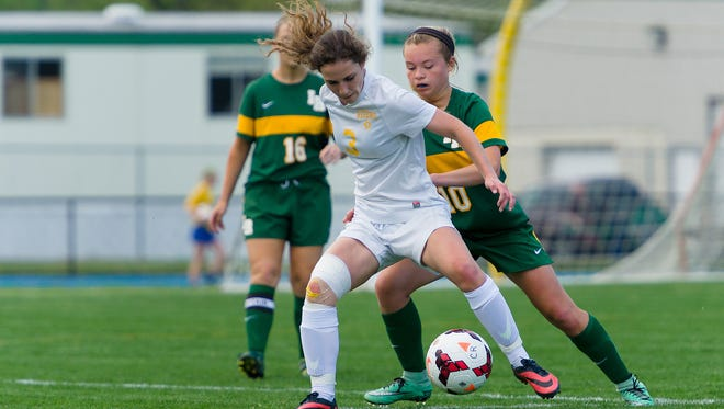 Caesar Rodney's Aleya Cummings (3) recorded a first-half hat trick as the Riders advanced to the DIAA Division I girls soccer semifinals.