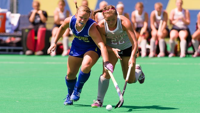 Delaware's Kayla Devlin (#13) competes for the ball against Kelsey Nolan (#22) of Ohio State in the Blue Hens' season-opening win.