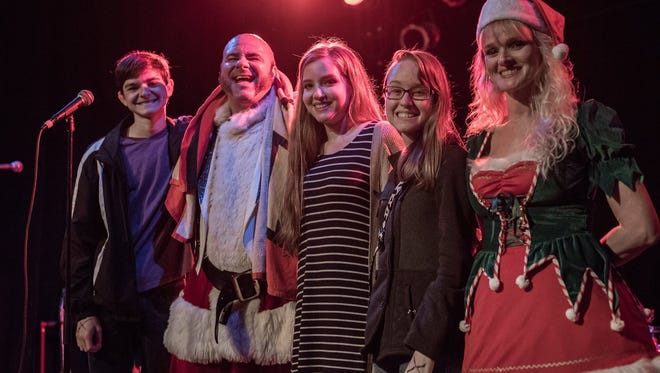 """A.J. Fratto, as """"Rock N' Roll Santa,"""" second from left, is seen with his family at last year's Toys for Tots concert at Vinyl Music Hall. Fratto has put together another charity concert this Saturday."""