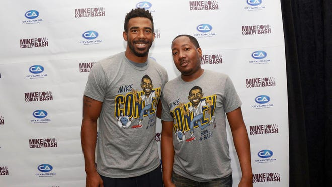 Mike Conley with Methodist University Hospital's Comprehensive Sickle Cell Center Director Mark Yancy at the annual Bowl 'N' Bash fundraiser.